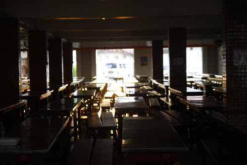 School canteen drenched with golden sunlight