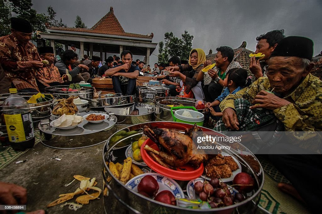 Indonesian muslims eat their food all together after pray for the Pictures  Getty Images