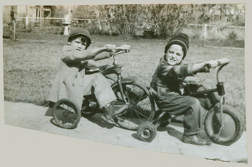 Two children on tricycles