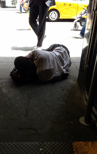 Asleep in the subway entrance, Midtown