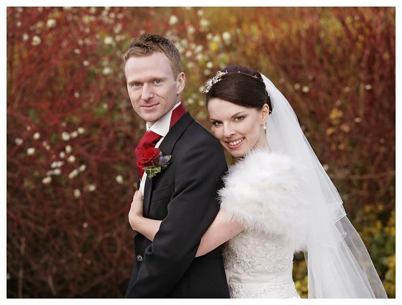 Wedding photography at the Reid Rooms_Essex wedding photography_Phil Lynch Photographer, Bride and groom wedding portrait with red background