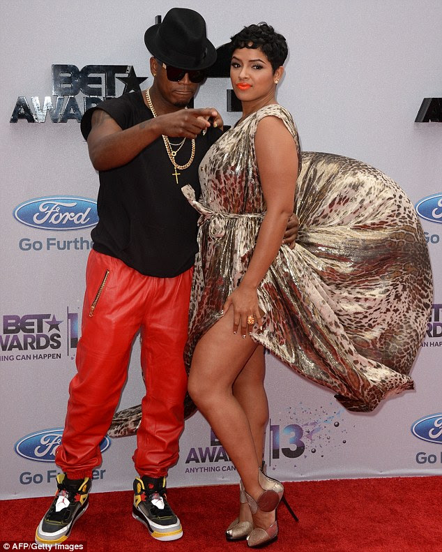 Another malfunction! Monyetta Shaw's metallic dress also flew up as she arrived with Ne-YO to the awards ceremony