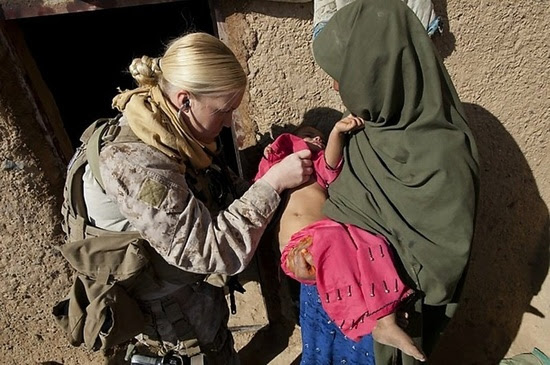 Lieutenant Michelle Sapphire in Afghanistan during a medical outreach visit to a local village.