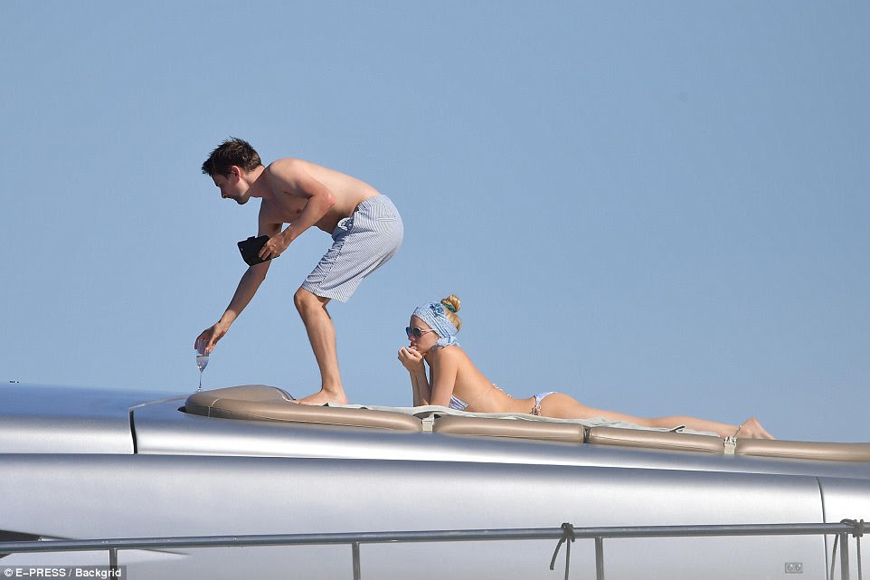 Stretching out: The statuesque star stretched out on her stomach, settling in for the long haul