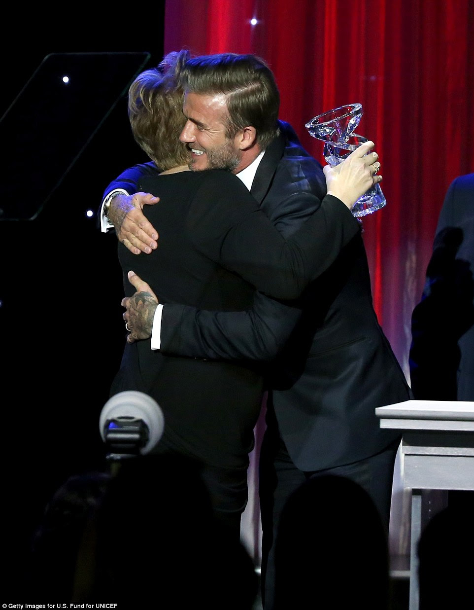 Special moment: David was presented the award by old friend Sir Elton John in Beverly Hills