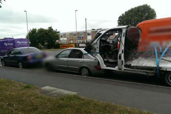 Car tows van towing car