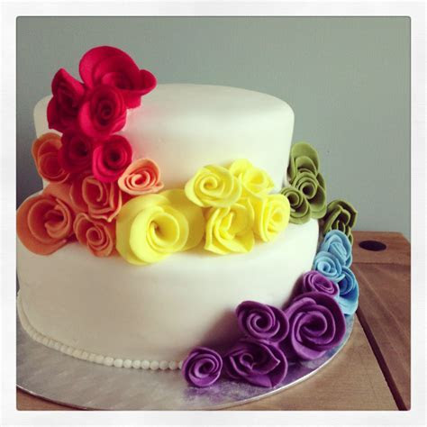 Rainbow wedding cake  ..I could put the real flowers on