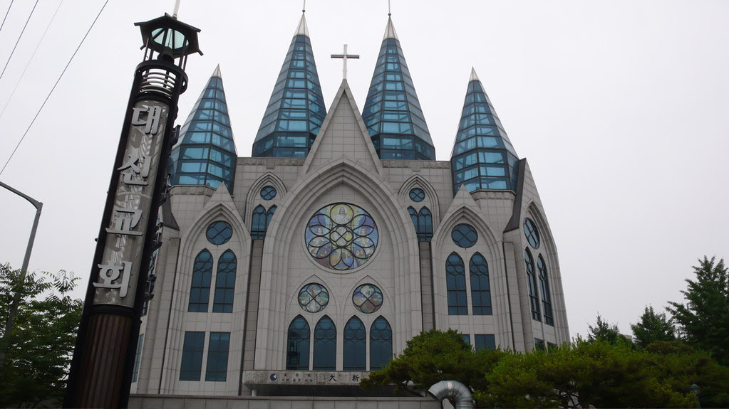 interesting modern church with four glass spires outside Onsu station, seoul