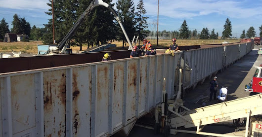 Worker trapped in rail car filled with sand rescued
