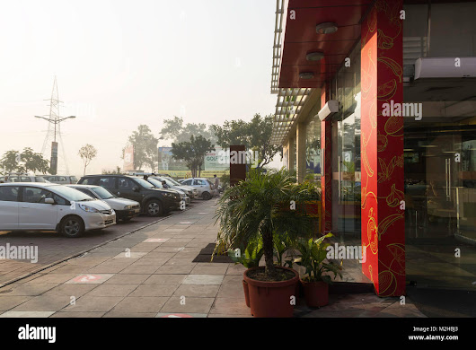 Stock Photo - A number of cars parked in front of the Haldiram restaurant, part of the Namaste Midway food court on the Delhi Hardwar highway, at Mansurpur in Uttar