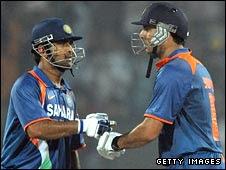 Mahendra Singh Dhoni (left)congratulates Yuvraj Singh