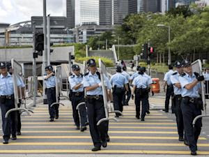 Police carry barriers outside Hong Kong government…