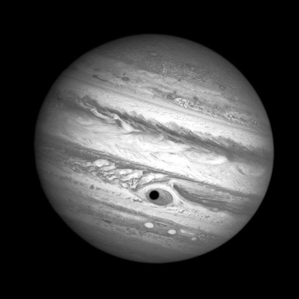 Jupiter's moon Ganymede casts a shadow on the giant planet's Great Red Spot, in this image taken by the Hubble Space Telescope on April 21, 2014.