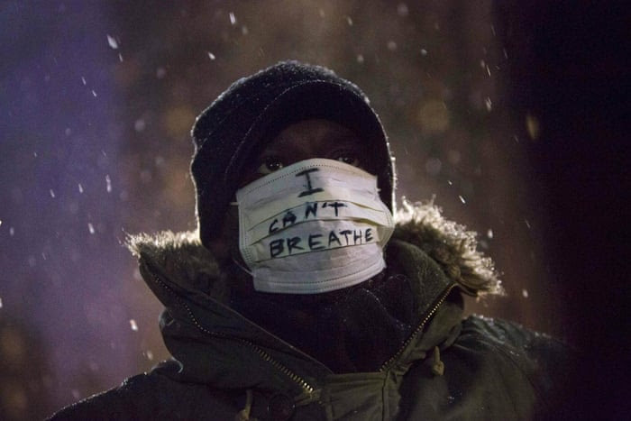 The demonstrations also continued in New York. Here, a man protests in falling snow following a news conference where members of Justice League NYC presented a list of demands at City Hall. The league, made up of juvenile and criminal justice advocates, artists and experts, and formerly incarcerated individuals, issued the demands in response to the failure of a Staten Island grand jury to indict white police officer Daniel Pantaleo for the chokehold death of Eric Garner