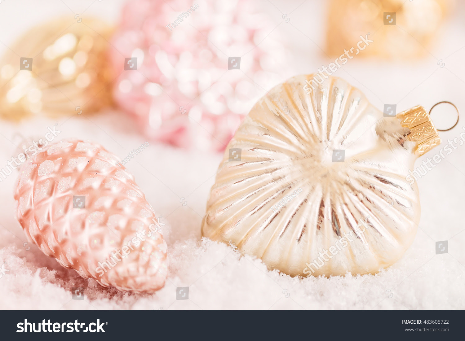 http://www.shutterstock.com/pic-483605722/stock-photo-closeup-antique-style-glass-christmas-decorations-on-snow-background-shallow-focus.html