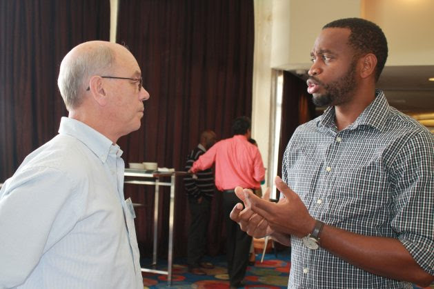 Dr. Donneil Cain (right), the Caribbean Community Climate Change Centre's (CCCCC) project development specialist who worked with the BWA on the Barbados Water Resilience Nexus for Sustainability Project, in discussion with Dr. Adrian Cashman from the University of the West Indies, Cave Hill on the educational institutions that assisted with the project's development. Credit: Zadie Neufville