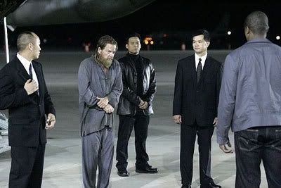 Chinese officials watch as Jack Bauer is released to CTU (Counter-Terrorist Unit) authorities at the start of Day 6.