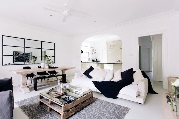 Le Fashion Blog Australian Blogger Brooke Testoni Bright Minimal Home Living Dining Room Open Floor Plan Pallet Coffee Table White Floors Print Rug White Sofa