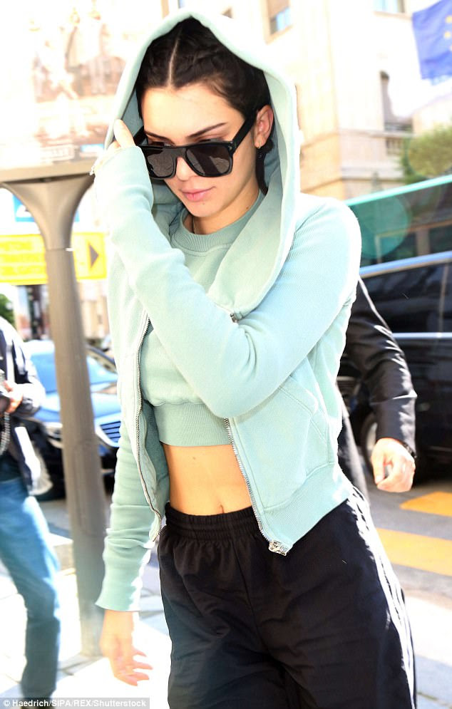 Cool and casual: The Keeping Up With The Kardashians star, 21, embraced a casual look in an abs-baring cropped top and matching hooded sweatshirt