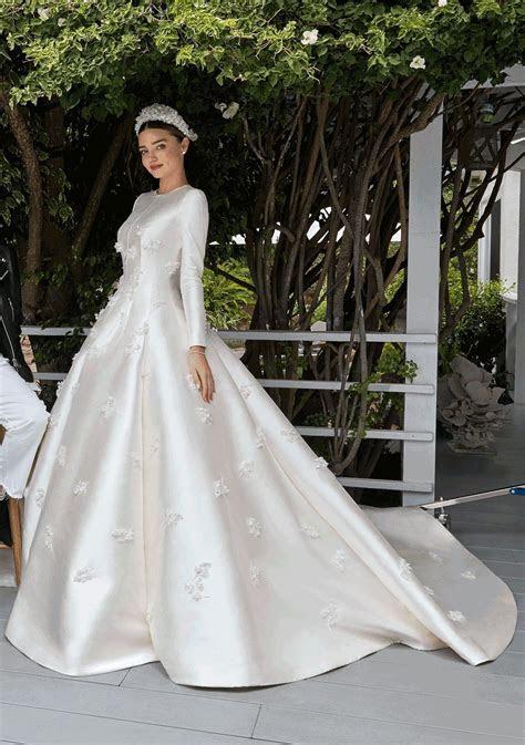 Miranda Kerr ties the knot in custom Christian Dior. #