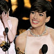 Tears, triumph and a spectacular tumble! Anne Hathaway, Daniel Day-Lewis, Ben Affleck and Jennifer Lawrence win big at Oscars