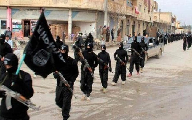 File photo of Isil fighters marching in Raqqa, the group's de facto capital