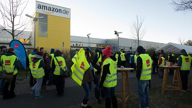 Employees of internet retail giant Amazon stage a strike in front of the company's logistics centre in Germany, on November 2...