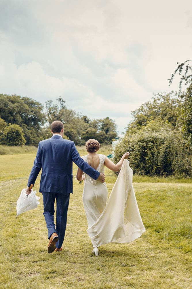 Bride and groom take a walk, Great Wilbrham, Cambridgeshire - www.helloromance.co.uk