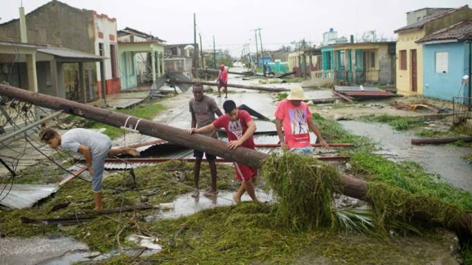 People walk on a damaged street after the passage of Hurricane Irma in Caibarien, Cuba (Alexandre Meneghini: Reuters)