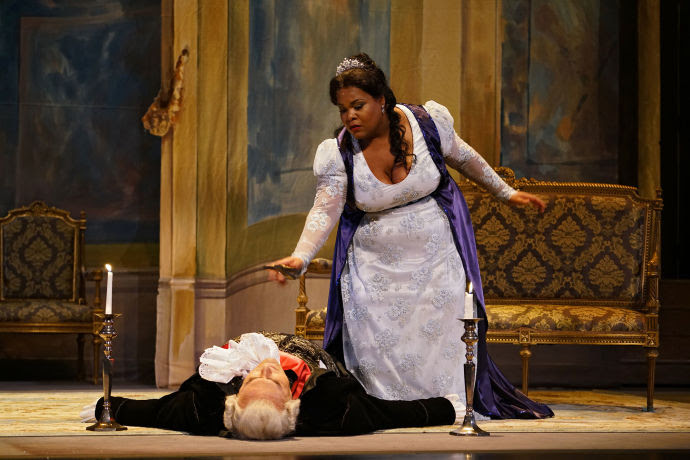 "Latonia Moore as Floria Tosca and Carlo Guelfi as the doomed Baron Scarpia in the New York City Opera Renaissance production of Puccini's ""Tosca,"" at Jazz at Lincoln Center's Rose Theatre."