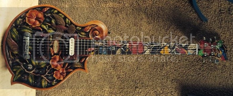 guitar blog blueberry highly carved and inlaid floral electric guitar with mandolin shape body. Black Bedroom Furniture Sets. Home Design Ideas