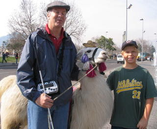 Mike and Wyndham cozying up to a llama
