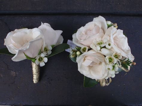 Matching Boutonniere and Corsage with white spray roses