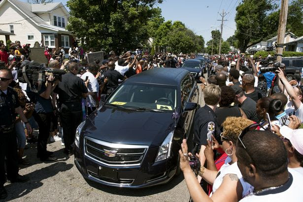 The motorcade Muhammad Ali drives along in the funeral procession motorcade on Grand Avenue in front of Ali's childhood home