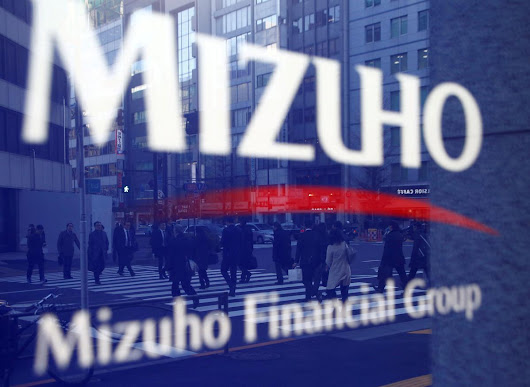 Japan's Mizuho sees pickup in U.S. M&A lending after tax cut