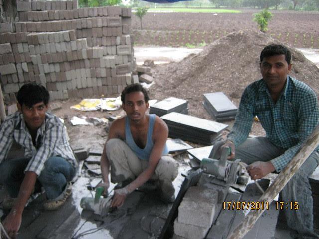 Tile cutters working on Sunday evening at Mont Vert Vesta Urawade Pirangut Pune 412 108