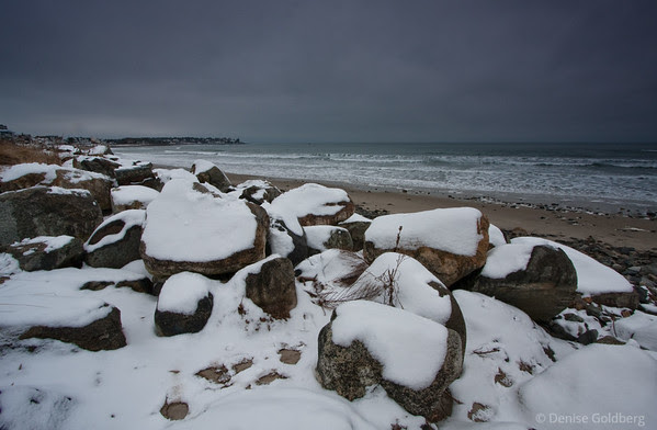snow-covered rocks along the New Hampshire coast