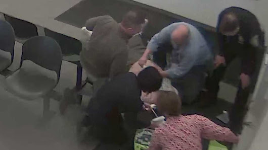 Officers administer CPR to man sitting in police station lobby