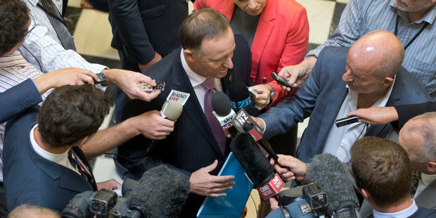 Prime Minister John Key in a media scrum before announcing the Government's decision over Isis in Parliament yesterday. Photo / Mark Mitchell