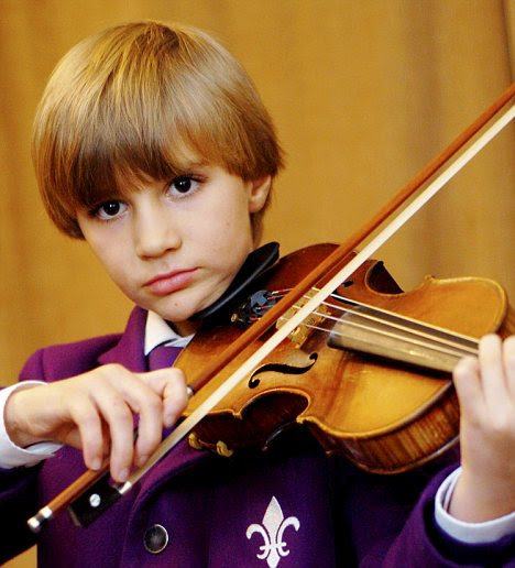 'Mini-Mozart' who has passed highest exam in violin and piano becomes Britain's youngest composer...at SEVEN