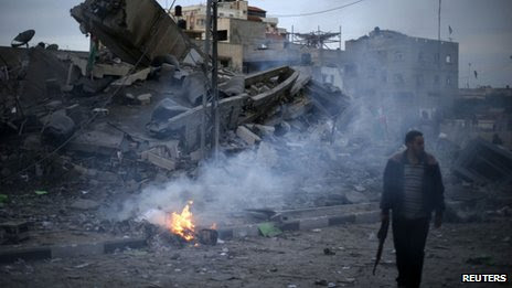 Hamas policeman guards destroyed office of PM Ismail Haniyeh (17 Nov)