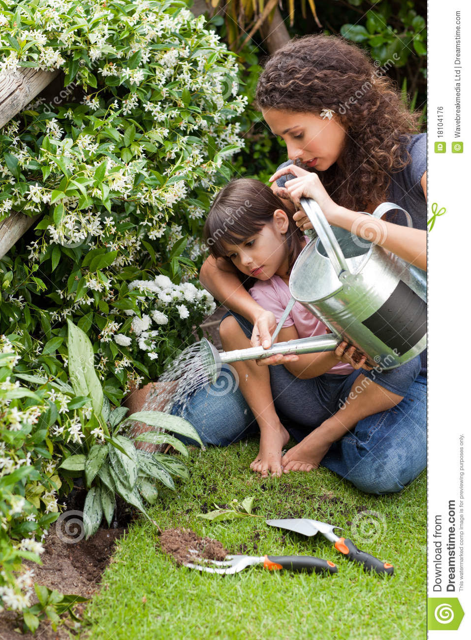 Download Happy Young Mother With Daughter Watering Plant Royalty ...