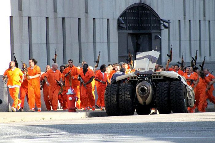 Dozens of inmates who broke out of prison approach the Tumbler in THE DARK KNIGHT RISES.