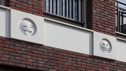 This building uses emoji cast in concrete as modern gargoyles