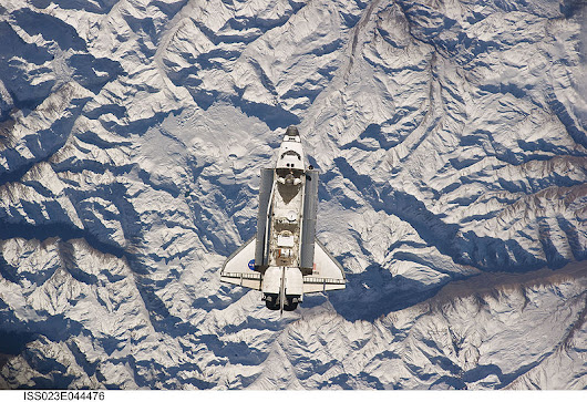 Space Shuttle Atlantis Over The Andes Mountains.