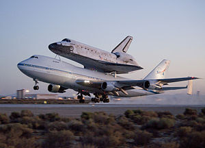 Space shuttle Discovery and its modified 747 c...