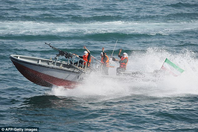 The USS Mahan had to take evasive action as the Iranian fast attack craft approached it in the Persian Gulf on Monday. Pictured is an Iranian speedboat in 2010