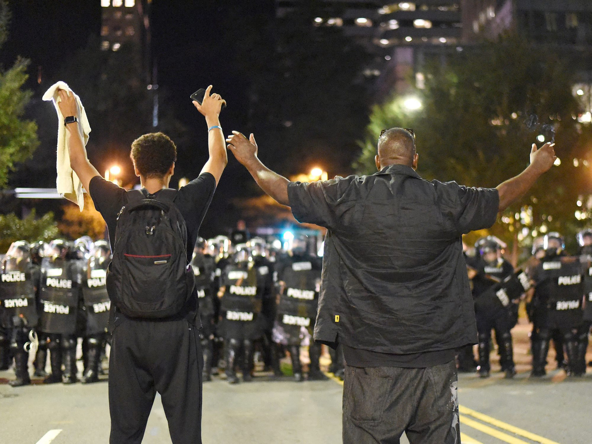 Protesters shout and confront riot police officers in Charlotte, North Carolina, USA