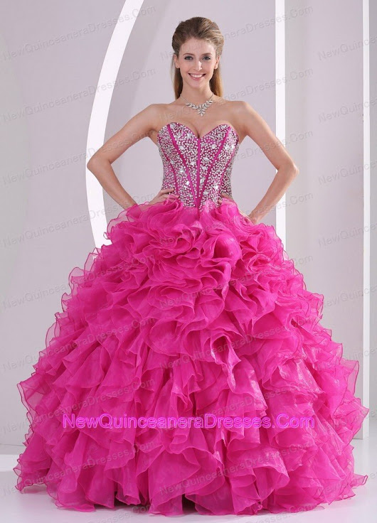 www.newquinceaneradresses.com/products/big/121909/Fuchsia-Ruffles-Ball-Gown-Sweetheart-Beaded-Decorate-Quinceanera-Gowns-in-Sweet-16-200.jpg