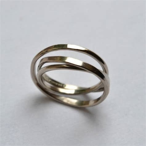 handmade white gold cosmic wedding ring by fran regan
